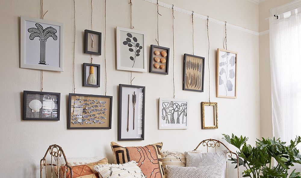 Hang artworks and photographs Ways to modernize your home décor